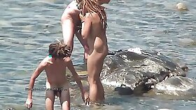 After stripping and play with phone on this young woman gets poked on the beach