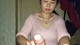 Asian chick fulfills her day with massage called handjob