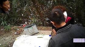 Bosomy Asian MILF has her fucking holes banged outdoor