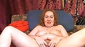 Red haired chunky woman playing with big tighs opens up her legs for me on cam
