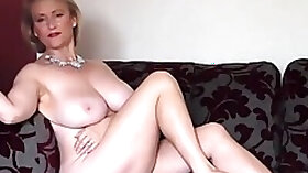 Busty blonde chick Michelle starts stripping to reveal her round boobs