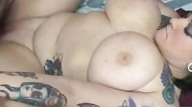 Casanna Harris has a lot of tattoos on her belly and her pussy is red