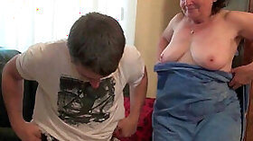young and sexy woman shows her tits and sucks two cocks on couch