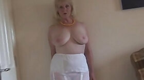 Busty Mature Strip Teases and Plays with toys