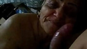 granny with a hard dick is giving a good blowjob